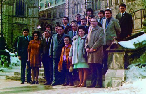 The Yukon First Nation delegation stands in front of the Parliament buildings in Ottawa in 1973 during their visit to . This is when they presented Together Today for Our Children Tomorrow to the Prime Minister. (Photo: Yukon Archives. Judy Gingell collection, 98/74, 1)