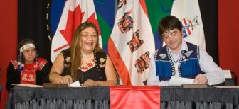 Georgina Sydney, negotiator and Peter Johnston, former Chief of Teslin Tlingit Council, sign the Administration of Justice Agreement in February 2011. (Photo: Canada)
